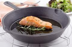 Grilled salmon fillet in a pan Stock Photos