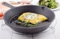 smoked cod with thyme and rosemary - stock photo