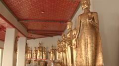 Standing Gold Buddha Statues at Wat Pho, Bangkok Thailand Stock Footage