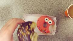 Stock Video Footage of Eating a donut Point Of View POV
