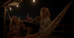 Teenagers drinking lemonade at night Stock Footage