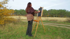 Woman Drawing A Picture At Nature Stock Footage
