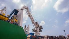 Time-lapse of Cranes Loading And Unloading Cargo From Ship At Port - stock footage