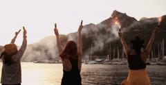 Grunge girls holding flares at the harbor in the evening Stock Footage