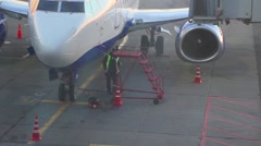 Airport worker prepares a ladder for a pilot, aircraft Stock Footage