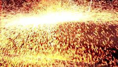 Stock Video Footage of Sparks, open surface of slab.