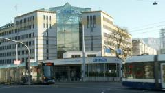 Street cars crossing in front of the UNHCR building in Geneva, Switzerland Stock Footage