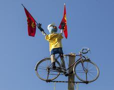 Funny Cyclist Mascot - stock photo
