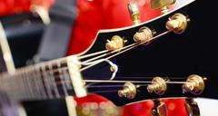 Black electric guitar headstock - stock photo