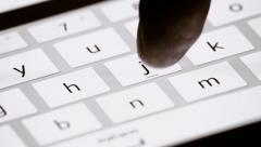 Finger touching virtual keys form a digital keyboard of a touchscreen Stock Footage