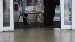 People with Shopping Cart Walking Through the Doors of Supermarket.  0096 Stock Footage