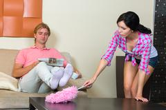 Young woman removes the apartment - stock photo