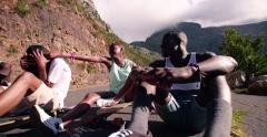 Mixed racial group of teenage longboarders happily sitting together Stock Footage