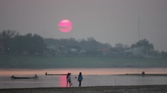 Sunset at Hat Don Chan Mekong,Vientiane,Laos Stock Footage