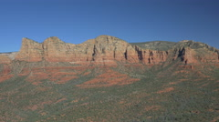 Stock Video Footage of Sedona hill and rocks with trees, Arizona