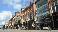 time lapse people shopping by harvey nichols on briggate leeds uk - stock footage
