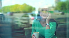 Friend Call,  view of girl finishing her telephone conversation Stock Footage