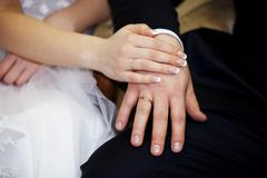 Newlyweds holding hands - stock photo