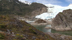Land of Fire, rocks and glacier, pan Stock Footage