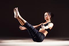 Beautiful woman is doing yoga asana Stock Photos