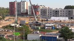 Workers building flat apartment house with crane Arkistovideo