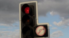 Traffic light changing from red to green united kingdom Stock Footage