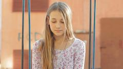 Sad Lonely Young Girl Sitting on Swing HD - stock footage