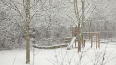 Snow falling in the courtyard with a playground. Stock Footage