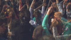 Fans Applauding To Music Band Live Performing a Concert on Stage in Open Arena - stock footage