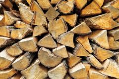 Background of chopped firewood logs in a pile - stock photo