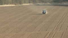 Tractor-mounted fertiliser distributor in use. Stock Footage