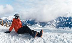 Snowboarder admiring the stunning view - stock photo