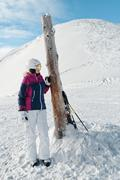 Young female skier admiring the stunning view - stock photo
