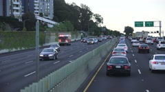 Fire truck and police car SF bay area freeway Stock Footage