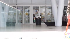 Shopping center, mall, automatic doors with customers. Stock Footage