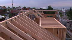 Time lapse of roof construction, carpenters at work - stock footage