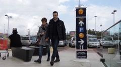 Billboard, ad space, sky, customers walking Stock Footage