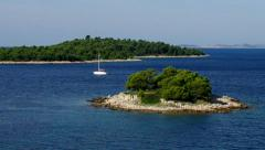 Island in Adriatic Sea and boat Stock Footage