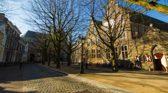Ree-lined street with old houses, Leiden, The Netherlands, 4K hyperlapse Stock Footage