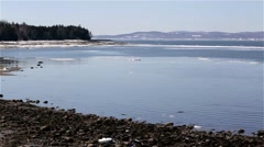 Pan of tip of Sears Island in Searsport Maine plus pier Stock Footage