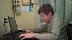 A child playing a computer game. Stock Footage