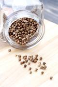 Stock Photo of Mustard seeds in jar - studio shot