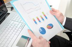 Businessman checking financial graphs - stock photo