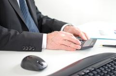 Businessman calculating financial results Stock Photos