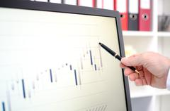 Stock exchange data graph on a screen - stock photo