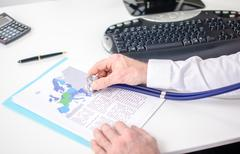 Economic document analysed with a stethoscope Stock Photos