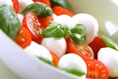 Stock Photo of Close of tomato and mozarella in dish