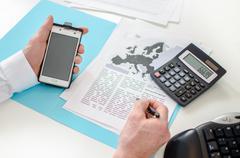 Businessman working on a economic document Stock Photos