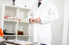 Doctor arriving in office - stock photo