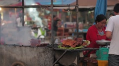 Barbeque chicken seller,Vang Vieng,Laos Stock Footage